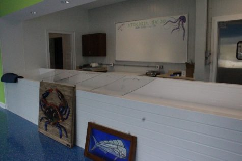 """The construction crew had just finished the final touches on the new building. Owner G. Phillip David told Port City Daily, """"we'll be decorating the next couple of days. Then we'll get the fish in there."""" (Photo Benjamin Schachtman)"""