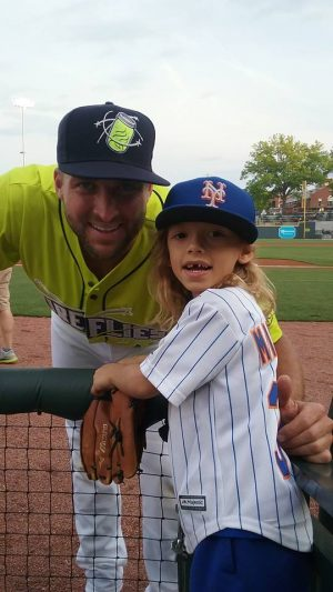 Tim Tebow, left, poses with Ashtin Gerberg prior to Wednesday night's game. Photo courtesy- Aaron Gerberg.