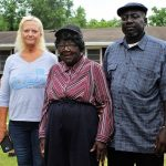 Kristen Johnson (L), with Martha Corbett (M), and Fred Corbett (R). After seven months, their homes are finally being repaired. (Port City Daily photo/CORY MANNION)