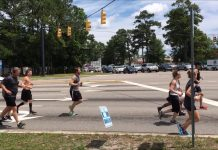 Law enforcement escorts blocked Military Cutoff and Eastwood as runners made their way across the intersection. (Port City Daily photo / STAFF PHOTO)