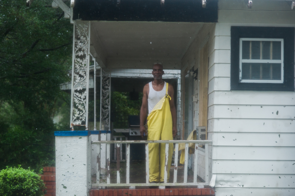 Marvin Haskins stands on his front porch in the Carolina Place neighborhood east of downtown Wilmington Friday morning during the calm between the inner bands of Hurricane Florence Friday morning. Haskins' fiancée has lived in the house, which appeared to be undamaged at that point, for 15 years. (Port City Daily photo   Mark Darrough)