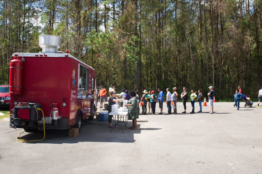 Poor Piggy's BBQ truck handing out chef-prepared World Central Kitchen meals at Gateway Community Church in Burgaw on Wednesday, Saturday 26, 2018. (Port City Daily photo | Mark Darrough)