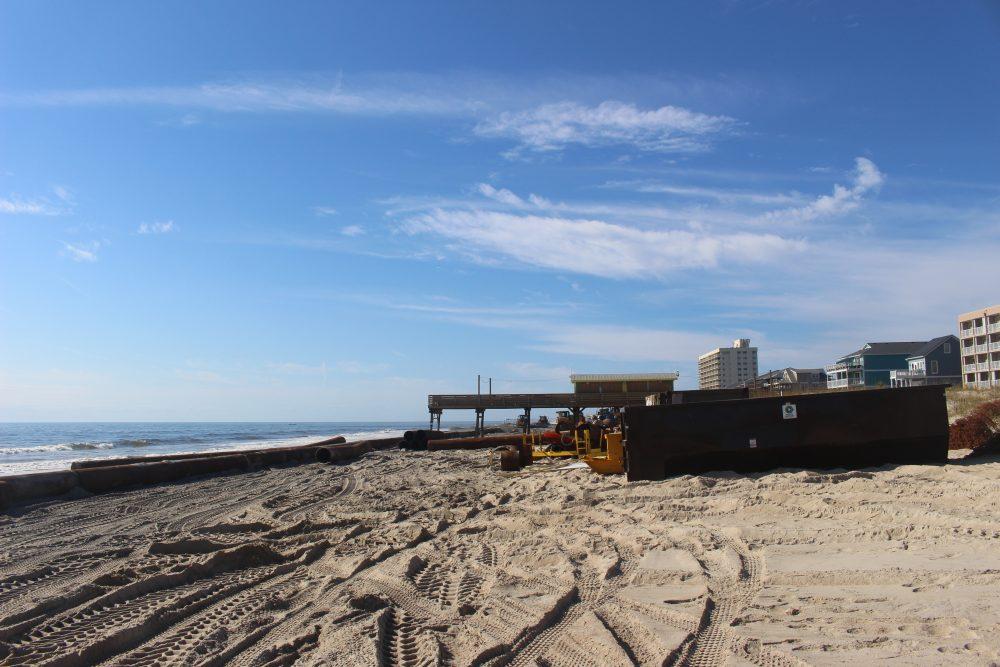 The beach nourishment project is making its way from Carolina Beach towards Kure Beach (Port City Daily/Michael Praats)