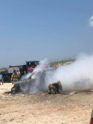 Pictures showing firefighters responding to a burning vehicle at Carolina Beach (Port City Daily / Kate Taylor via Facebook)