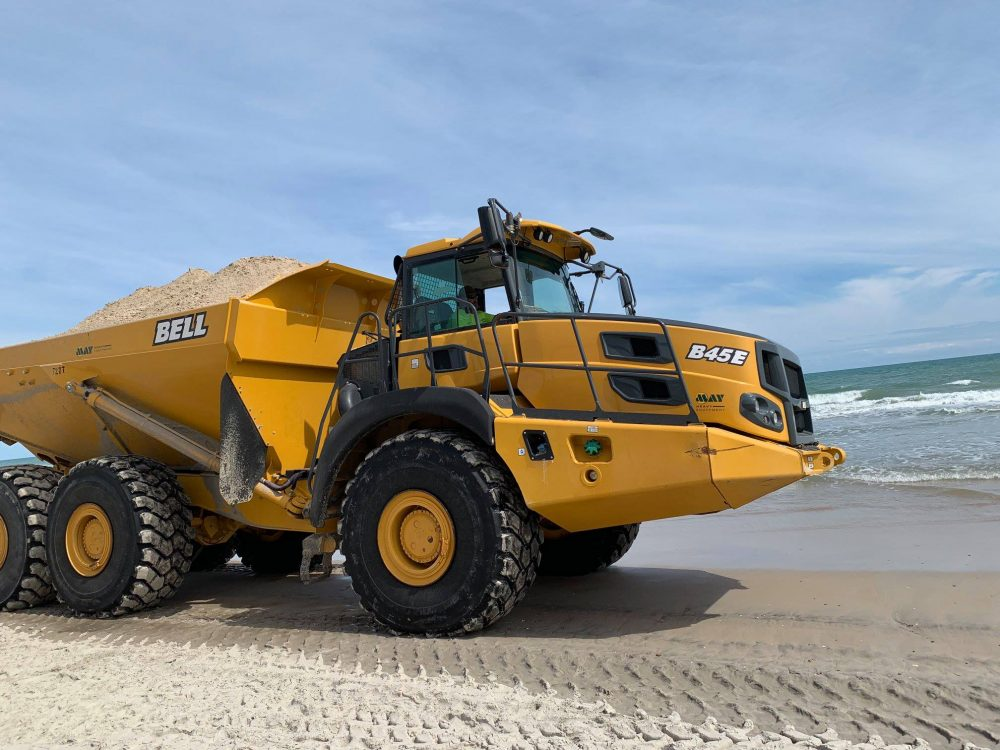 A sand-hauler drives on the Surf City beach in March. (Port City Daily photo/Courtesy Vicki Bozzola)