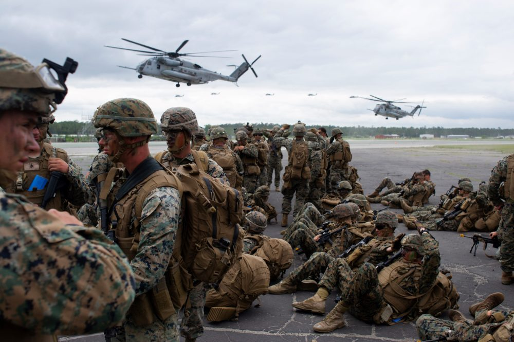 Ch-53 Stallions land at Bogue Airfield as infantry units from the 2nd Marine Division turn away from the dust and high winds. (Port City Daily photo/Mark Darrough)