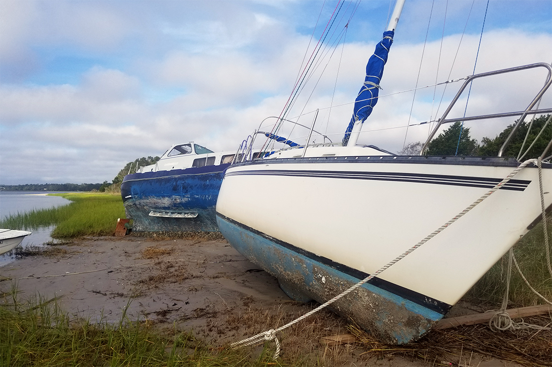 Local crews will begin to remove abandoned and derelict vessels along the shoreline identified by state agencies. (Port City Daily photo/Courtesy North Carolina Coastal Federation)