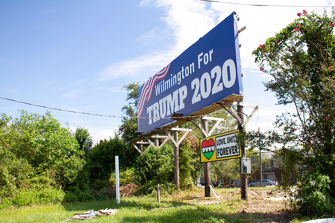 The Trump billboard, erected directly behind the Black Lives Do Matter art installation off Third Street, was vandalized in October 2020. (Port City Daily photo/Johanna F. Still)