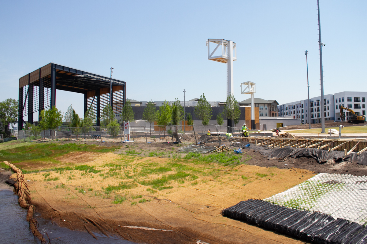 Contractors work on getting Riverfront Park ready for visitors as the City of Wilmington prepares for a Fourth of July grand opening. (Port City Daily photo/Johanna F. Still)